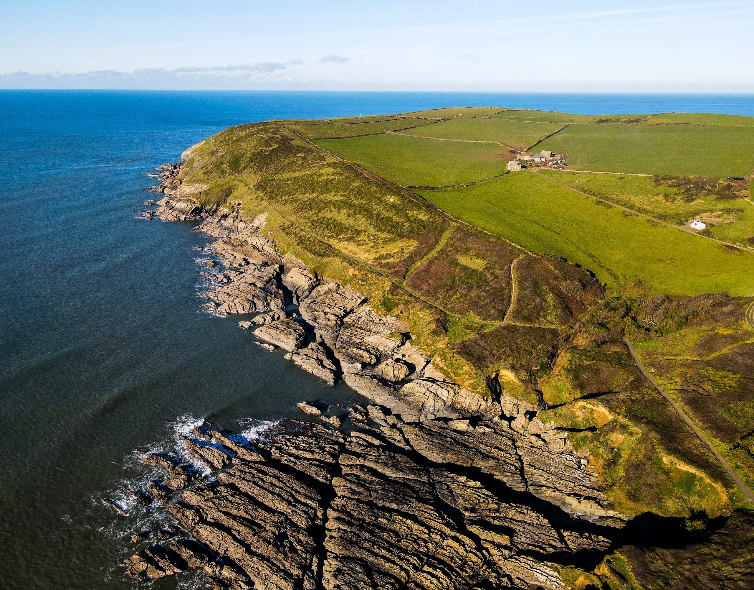 arial view of baggy point national trust headland croyde